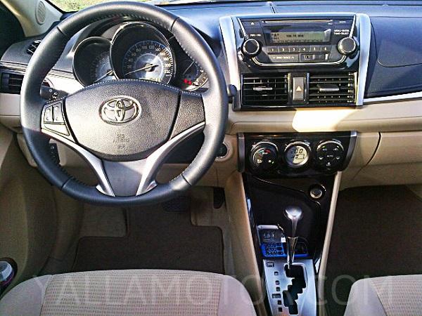 Road test 2014 toyota yaris sedan qatar yallamotor - 2014 toyota corolla interior features ...