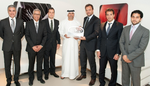 (centre) Umberto Cini presents the Outstanding Commitment 2011 Award to Saeed Al Tayer.