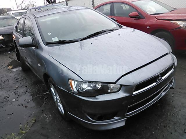 Mitsubishi Lancer 2014 Car for Sale in Sharjah